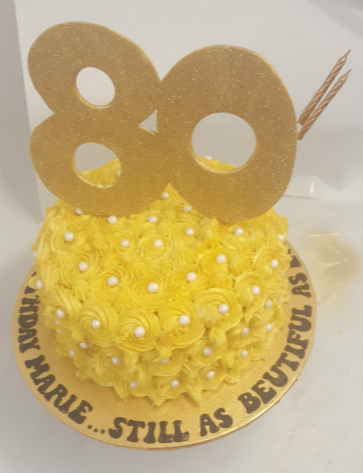 Yellow Rosettes 80th Birthday Cake